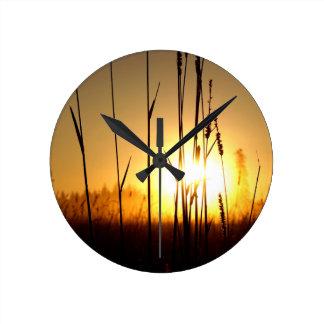 Horloge Ronde Lever de soleil brumeux sur l'île de St Joseph