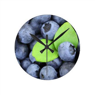 Horloge Ronde Myrtilles de baies de Noël