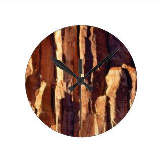 Horloge Ronde piliers d'or de grès