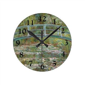 Horloge Ronde Pont d'art de Monet au-dessus d'un étang des