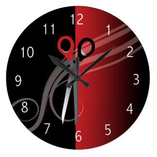 Horloge rouge et noire de salon de coiffure