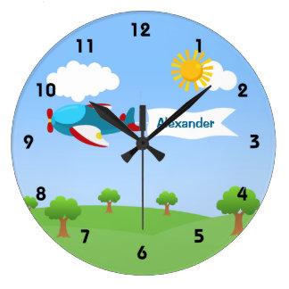 Horloges murales de garçon de banderole