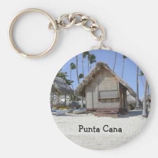 hutte d'herbe sur une plage tropicale porte-clé rond