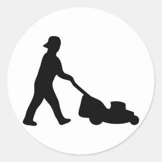 icône de tondeuse à gazon sticker rond