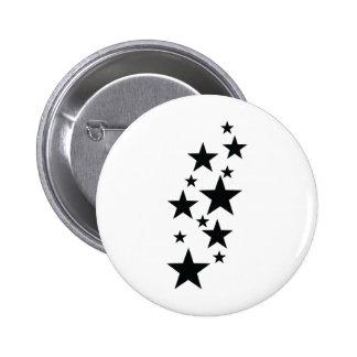 icône noire de pluie d'étoile badges avec agrafe