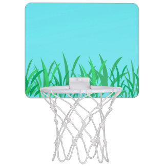 Illustration d'herbe verte et de ciel bleu mini-panier de basket