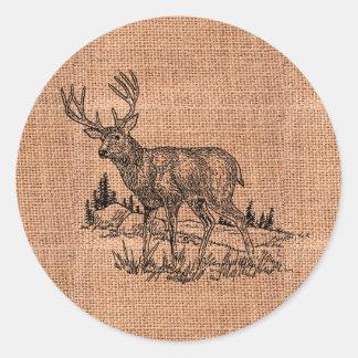 Illustration rustique de toile de jute et de cerfs sticker rond