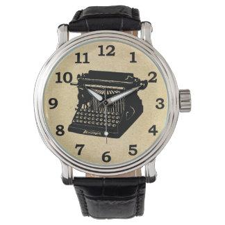 Image antique de cru de machine à écrire montres cadran
