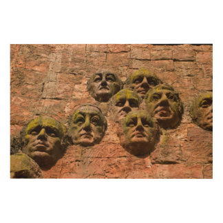 Impression Sur Bois Les visages sculptent sur le bâtiment