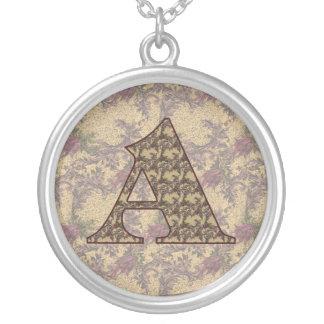Initiale de monogramme un collier floral élégant