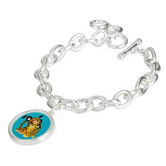 Jaguars mignons de bande dessinée dans le bracelet