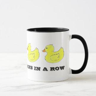 J'ai mes canards dans une tasse en caoutchouc de