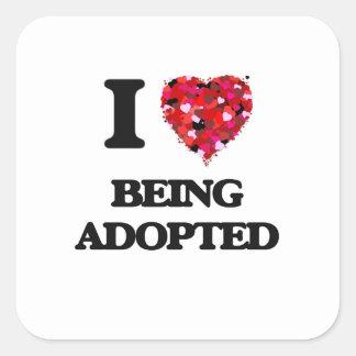J'aime être adoptée sticker carré