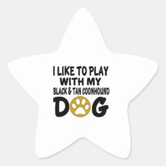 J'aime jouer avec mon chien noir et bronzage de sticker étoile