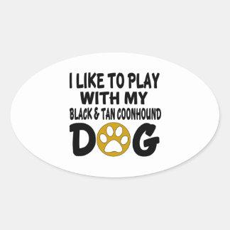 J'aime jouer avec mon chien noir et bronzage de sticker ovale