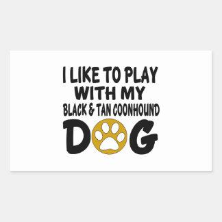 J'aime jouer avec mon chien noir et bronzage de sticker rectangulaire