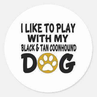 J'aime jouer avec mon chien noir et bronzage de sticker rond
