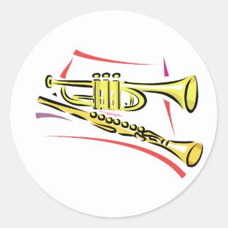 Jaune graphique d'image de saxo de trompette et de sticker rond