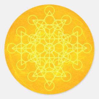 Jaune lumineux de la géométrie sacrée de mandala sticker rond