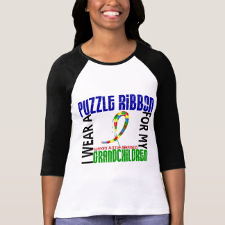 Je porte le ruban de puzzle pour l'autisme des t-shirt