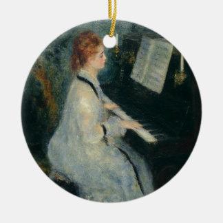 Jeu du piano par lueur d'une bougie ornement rond en céramique