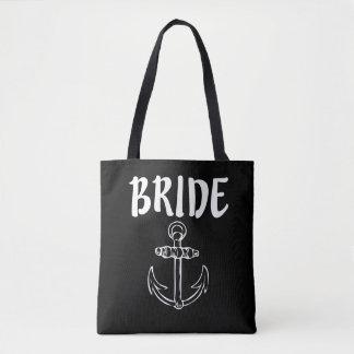 Jeune mariée avec le sac des femmes d'ancre