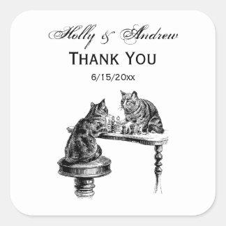 Jeux de société : Deux chats jouant une rencontre Sticker Carré