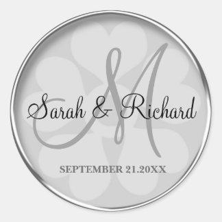 Joint décoré d'un monogramme de mariage sticker rond
