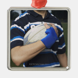 Joueur de rugby avec la boule ornement carré argenté