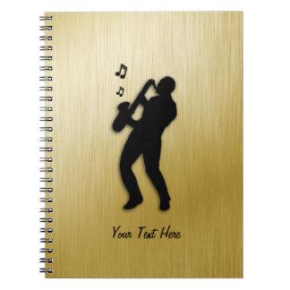 Joueur de saxophone d'or carnet