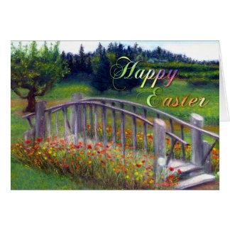 Joyeuses Pâques avec la passerelle, les fleurs, et Carte De Vœux