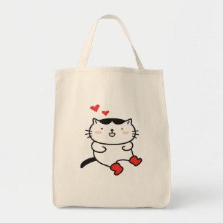 Kitty dans des sacs de bottes
