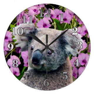 Koala et orchidées grande horloge ronde