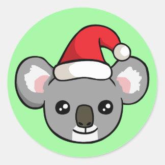 Koala mignon de Noël dans des autocollants de