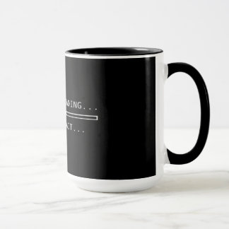 La caféine chargeant svp attendent la tasse