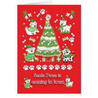 La carte de Noël de chien, pattes de Père Noël vie