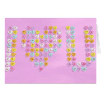 La carte de Valentine de coeurs de sucrerie avec