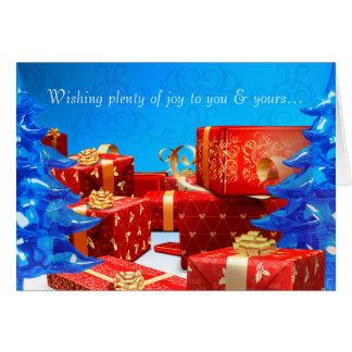 La carte de voeux rouge de cadeaux
