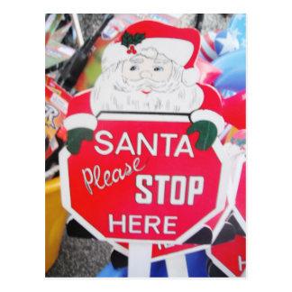 La carte postale Père Noël et l'arrêt ici signent