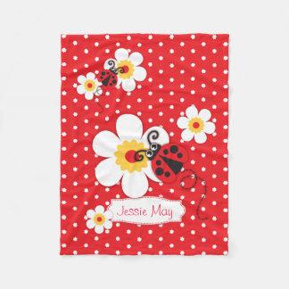La coccinelle de Ladybird fleurit la couverture