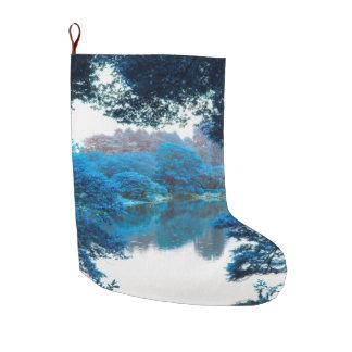 La couleur bleue a effectué la nature fraîche et grande chaussette de noël