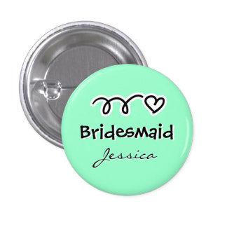 La demoiselle d'honneur verte en bon état boutonne badge