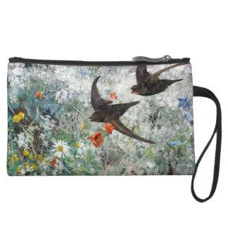La faune d'oiseaux d'hirondelle fleurit trousses avec anse