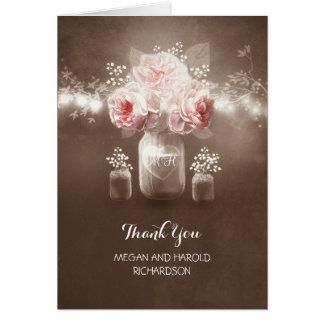 La ficelle rustique de pot de maçon allume le cartes de vœux