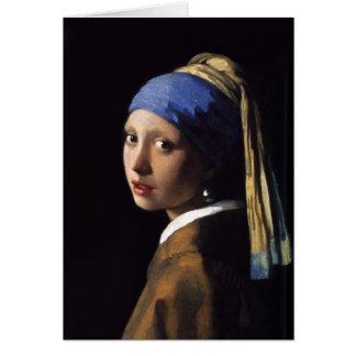 La fille avec une boucle d'oreille de perle par cartes