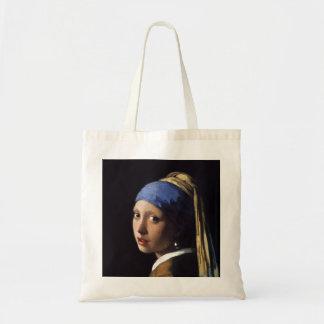 La fille avec une boucle d'oreille de perle par sacs de toile