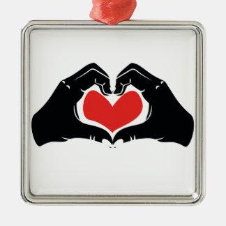 La forme de coeur remet l'illustration avec les ornement carré argenté
