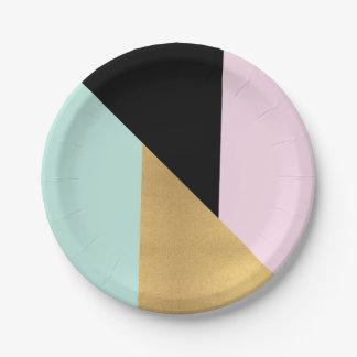 La géométrie métallique en verre d'or rose en bon assiettes en papier