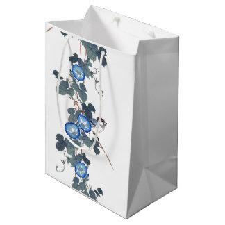 La gloire de matin bleue fleurit le sac de cadeau
