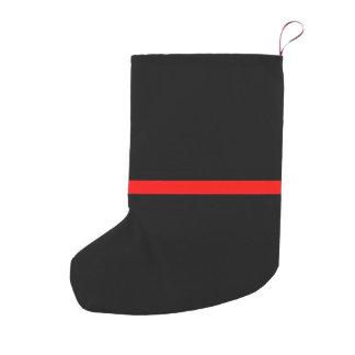 La ligne rouge mince symbolique déclaration sur a petite chaussette de noël